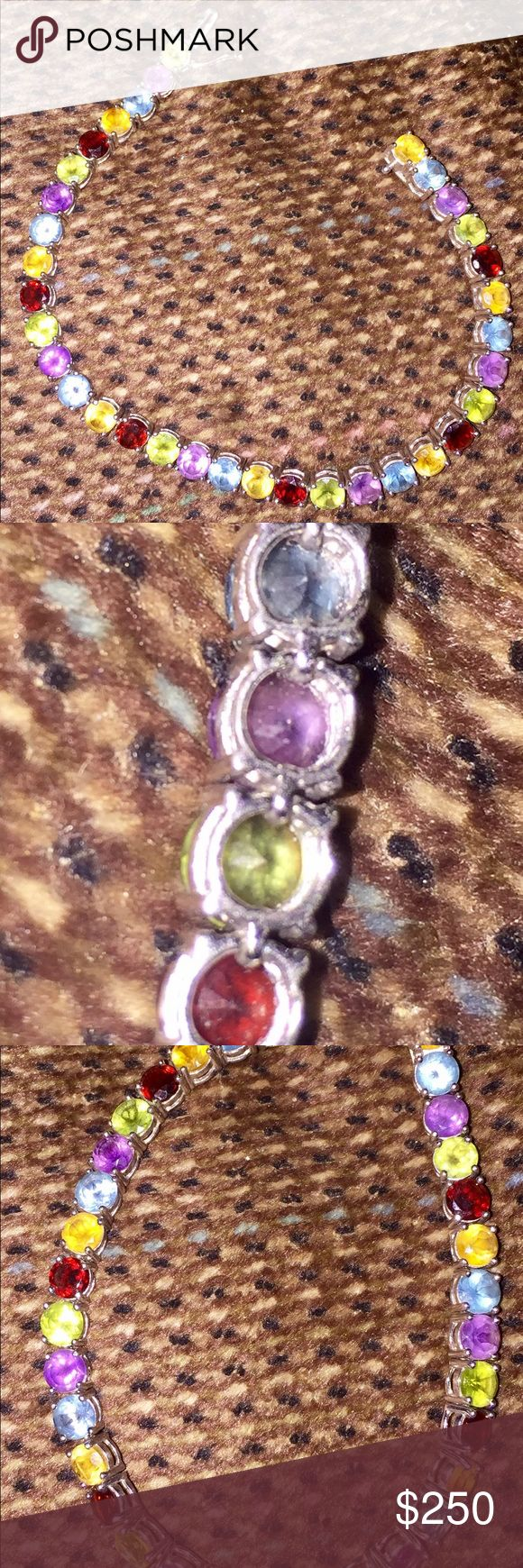Sterling Silver and Gemstones Tennis Bracelet Sterling Silver and Multi Colored Gemstones Tennis Bracelet. New .925 Stamped Sterling Silver Multi colored gemstones Safety latch/clasp Excellent/new condition  Purchased Macy's 2016  Original price $395 Price Firm Jewelry Bracelets