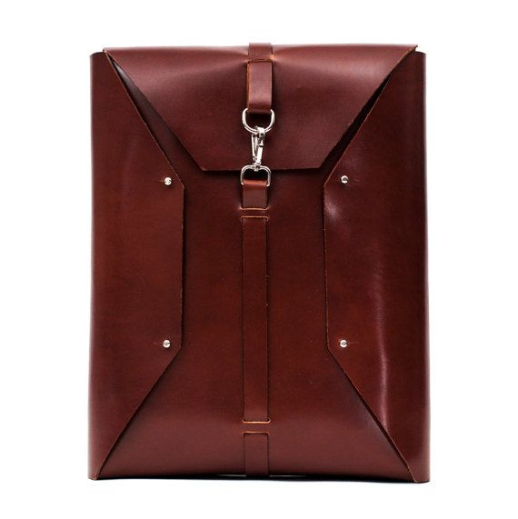 Dimensions: 14.96 inches tall (38 cm) 12.99 inches wide (33 cm)  2.36 inches deep (6 cm)  Need a larger or smaller bag? We can do that as well. Please contact us for more information. Handmade in Spain.  Leather color: Color and quality of leather will be as close as possible to the one in the picture, however leather shade may vary throughout the hide slightly due to nature of leather. Kindly advise if you need a specific color leather so that we can source it accordingly.  This item will…