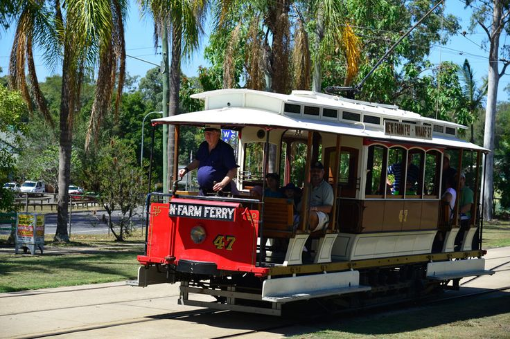 Vintage tram with passengers at the Brisbane Tramway Museum