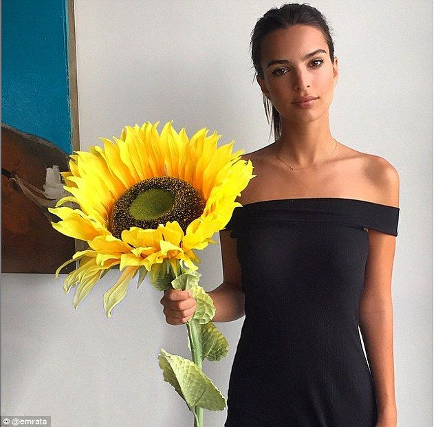Glam: Proving that her stunning looks could sell anything, Emily also shared a photo of herself posing with a huge flower as she quipped in the caption: 'Why not buy a giant sunflower?'