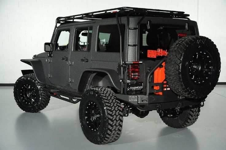 2014 Jeep Wrangler Unlimited with Kevlar Liner Finish in Mercedes Tectite Gray Exterior: Custom Roof Rack and Rear Bumper