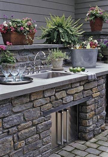 outdoor kitchen love the concrete worktop
