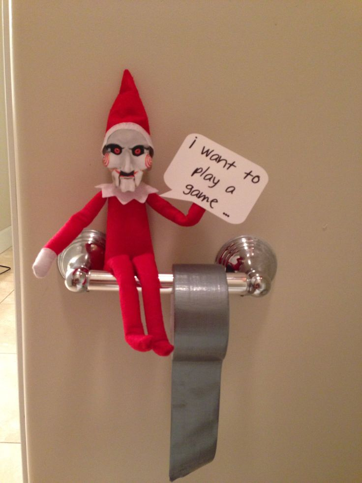 Elf on the shelf posing as Jigsaw from the movie Saw (With ...
