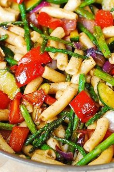 Make a tasty and healthy pasta salad loaded with roasted vegetables for a delicious side dish or an easy lunch to make ahead of time. Our recipe calls for fresh asparagus, pepper, zucchini and red onion tossed with a yummy dressing and whole wheat noodles.
