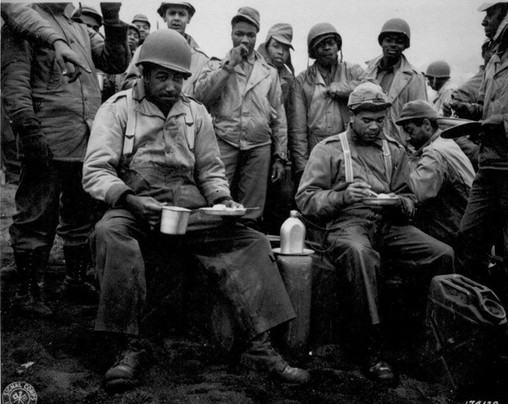 American soldiers of the labor battalion deployed by the US Army eating a meal in the field Massacre Bay Attu Aleutian Islands US Territory of Alaska 20 May 1943.