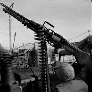"The M-60 Machine Gun in the Vietnam War The M60 machine gun was what the military called a ""crew-served weapon,"" requiring a team of three soldiers to transport, load, and fire it."