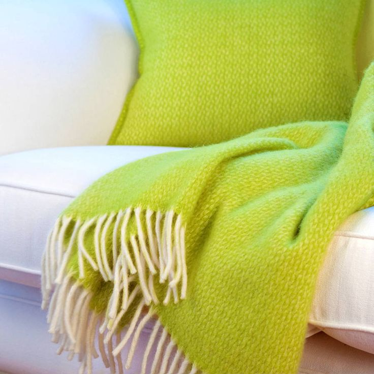 Sharpen up your soft furnishings with this sumptuous lime green genuine wool throw and matching wool cushion cover, spun from 100% decadent Italian wool.Can be purchased individually or as a set.A sure way to add a quick and striking detail to your home, available either individually or as a matching set. Interesting cushions and luxury throws have the unique ability to give your room the 5 minute facelift it might need. They can be the perfect way to shift the colour balance of a room…