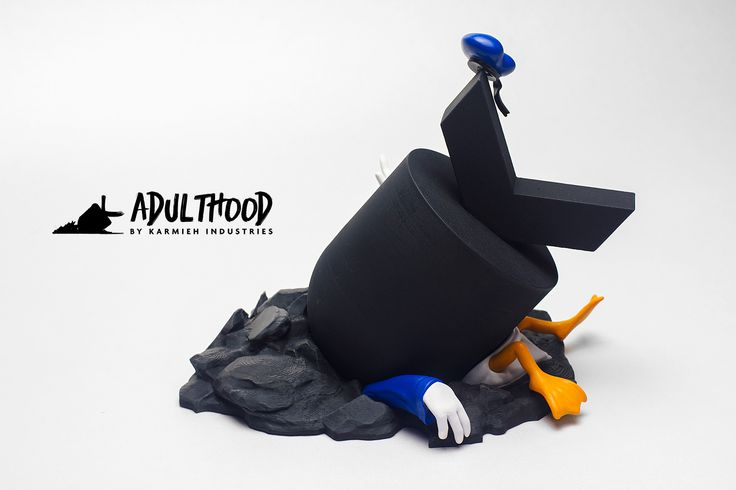 This Signed Limited Edition is a handcrafted art toy and limited to 15 unique pieces worldwide, that has been sculpted, hand cast and hand painted by Oasim Karmieh  The Art Toy can be displayed with or without the rubble base.  The Bomb can be displayed on it's own or with the duck tail and legs for a more simplisitic look or you can go with the full mayhem Edition.  It Stands around 6 Inches / 15 cm tall,  8 inches / 20 cm wide and 6 Inches / 15 cm long