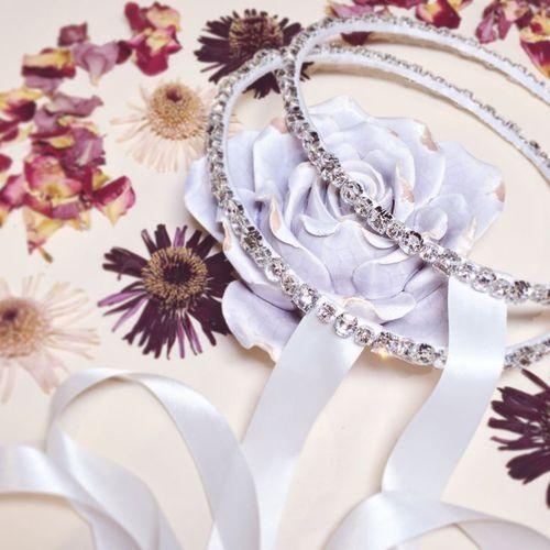 Swarovski Crystal Stefana connected with Satin White Ribbon