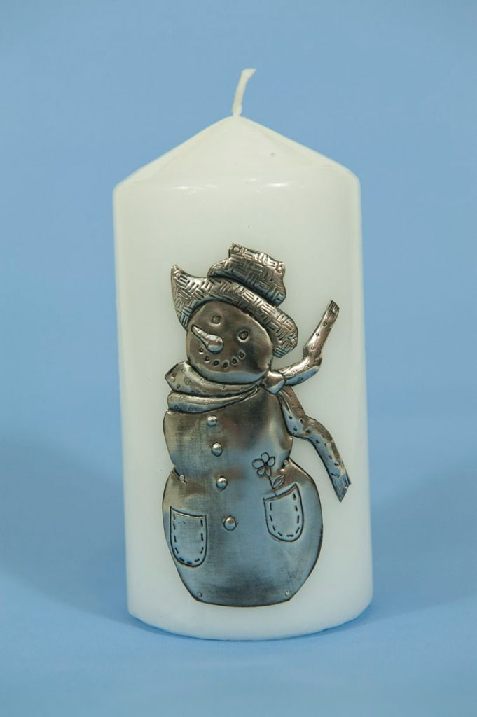 Snowman in pewter on candle. Handmade pewter by Sandy Griffiths...fhttp://annmack.co.za/?s=pewter+coasters