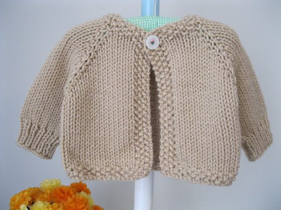 Hand knit baby sweater ...........cafe au lait cardigan with 'flower' button