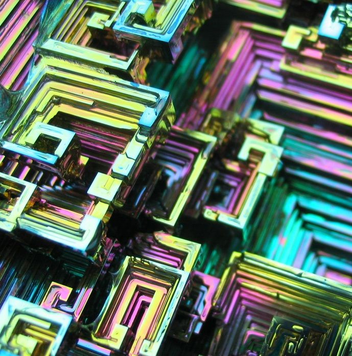 """Bismuth crystals   If you want one of the rarest bismuth crystals in the world, here it is!!! It was amazing seeing this creation come forth from the molten bismuth. Simply massive in size at 566 grams, and 4 1/2"""" by 4 1/8"""" by 3"""". It has gorgeous pastel colors of greens, pinks, oranges, yellows, purples, blues, browns and golds."""