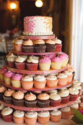 Wedding Cake with individual cupcakes for guests. Is this what you had in mind Brittany? I can def make this.
