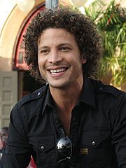 Justin Guarini (born Justin Eldrin Bell; October 28, 1978) is an American singer/songwriter and actor who rose to fame in 2002 as the first runner-up on the debut season of the television show American Idol.