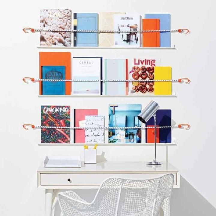 DIY Bungee Cord Magazine Shelves over the Desk - 28 Ways To Use Bungee Cords in Your Home - DIY Bungee Cord Hacks