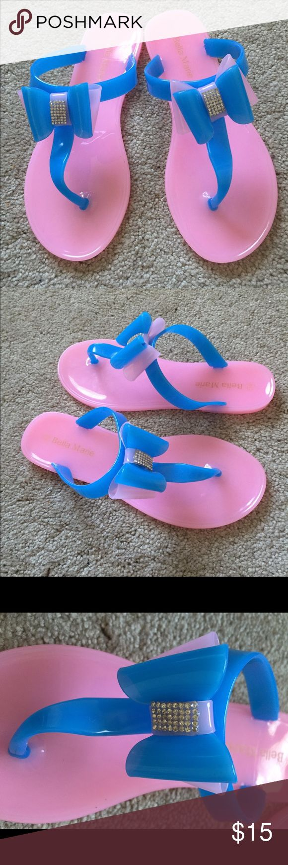 Brand New Pink & Royal Blue Bow Sandals Sz 6.5 These are a pretty Pink & Royal Blue Sandals. Flip Flops? Slide your feet into these beautiful things. Diamond accent in the middle of the bow. Shoes Sandals