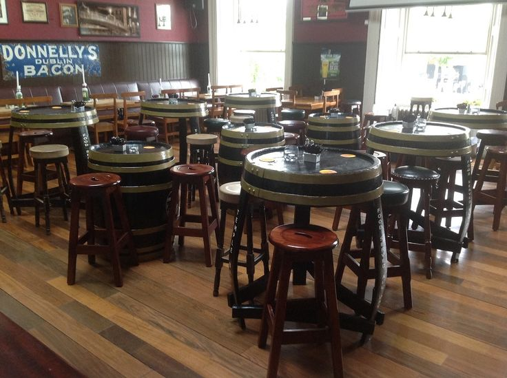 Whiskey Barrel pub tables and Branded Whiskey barrels By RKD Floral Displays