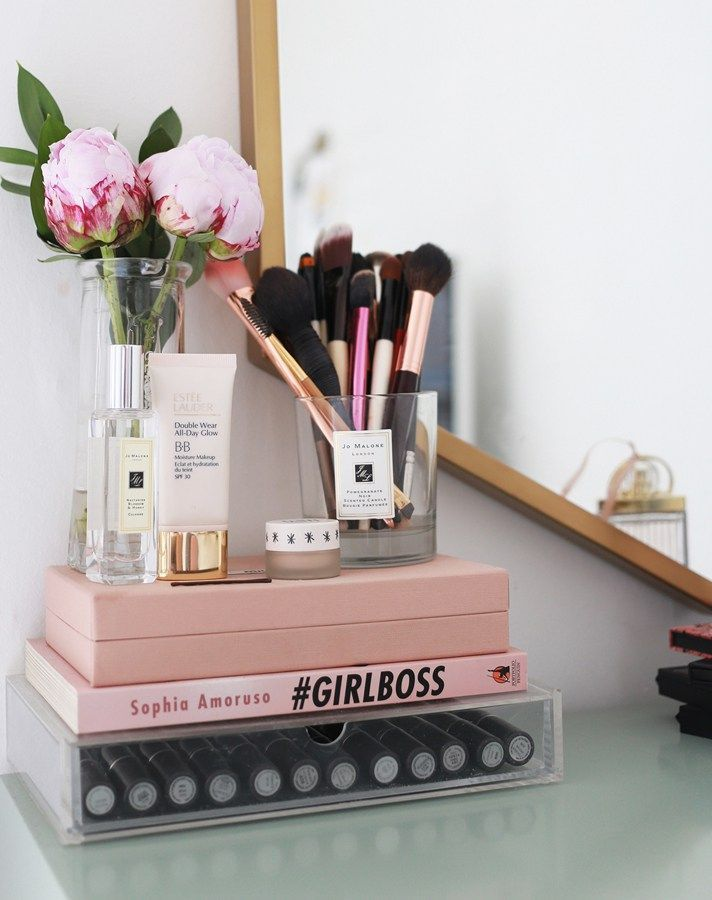17 gorgeous makeup storage ideas | beauty | vanity organization ideas | stack books on mini lucite drawers + reuse old candle holders