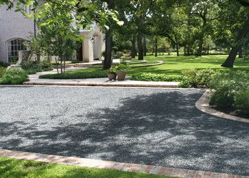 What a beautiful space! I was wondering what material you used for the driveway? Its darker than pea gravel - Houzz