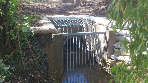 The summit of the Wey & Arun Canal near Dunsfold. New trap installed at the end of the culvert running under the road at Tickners. The culvert allows excess water in the summit pound between Tickners and Fastbridge to flow into the short pound south of the road. May 2014