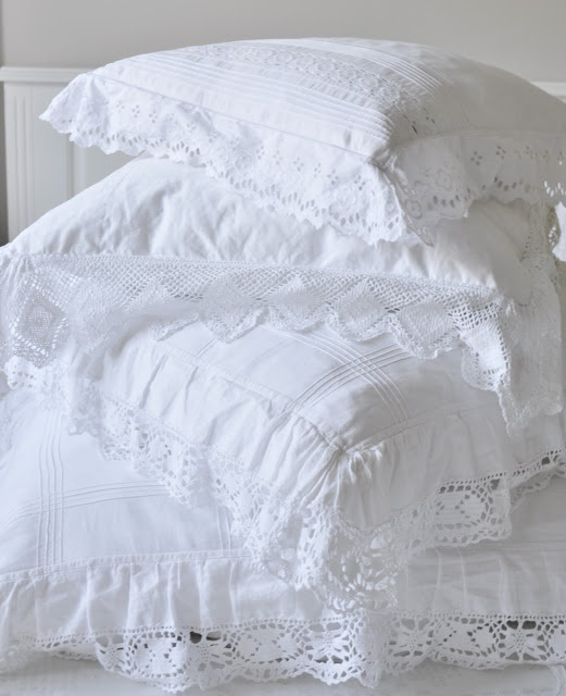 Beautiful selection of pristine white cushions, lacy and delicate.