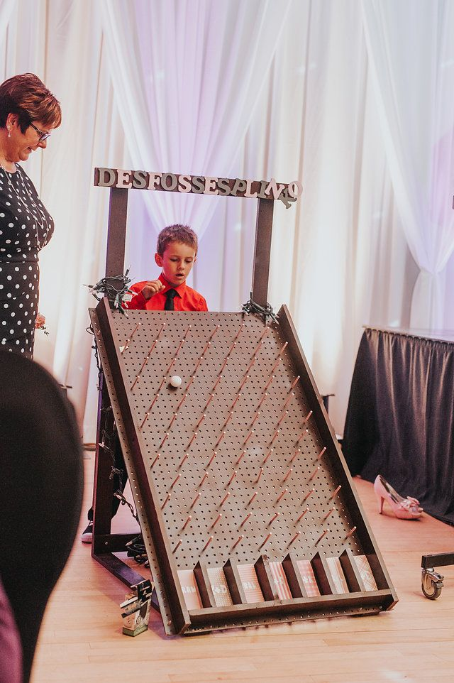 The Plinko board was a lot of fun! We used it for drink tickets at the start of the night, and to replace glass clinking later in the night. #wedding #kissinggames #weddingreception #reception #DIY