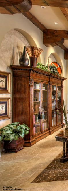 Beautiful Tuscan cabinet with great ideas for accessorizing above Armoires and kitchen cabinets.