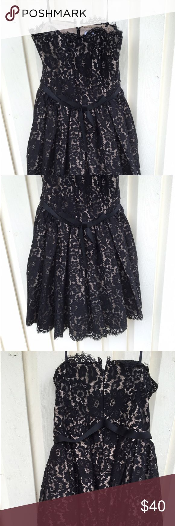 Black Illusion Lace Neiman Marcus Strapless Dress Black illusion lace strapless dress by Neiman Marcus/ Robert Rodriguez for Target. Has tan lining and boning in the bodice with lace detailing around the edges. Includes built in bra strap piece. Good condition no rips, stains, or tears. Fits size 6 or S. Neiman Marcus Dresses Strapless