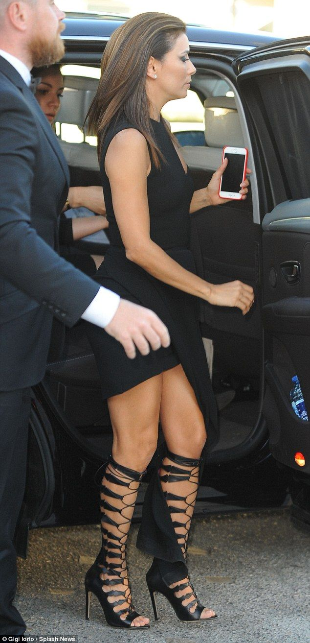 Eva Longoria looks ready for the arena in thigh-high gladiator sandals #dailymail