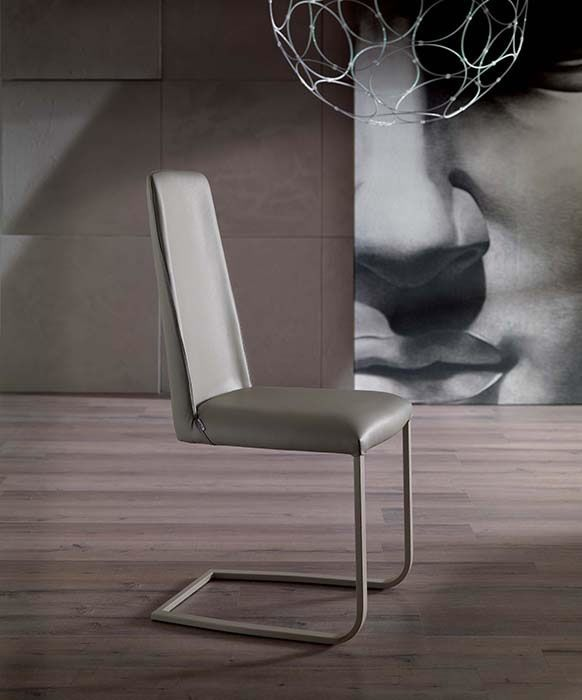 JAZZ design: Studio Ozeta  SLED PEDESTAL METAL FRAME CHAIR WITH SOFT LEATHER COVERING