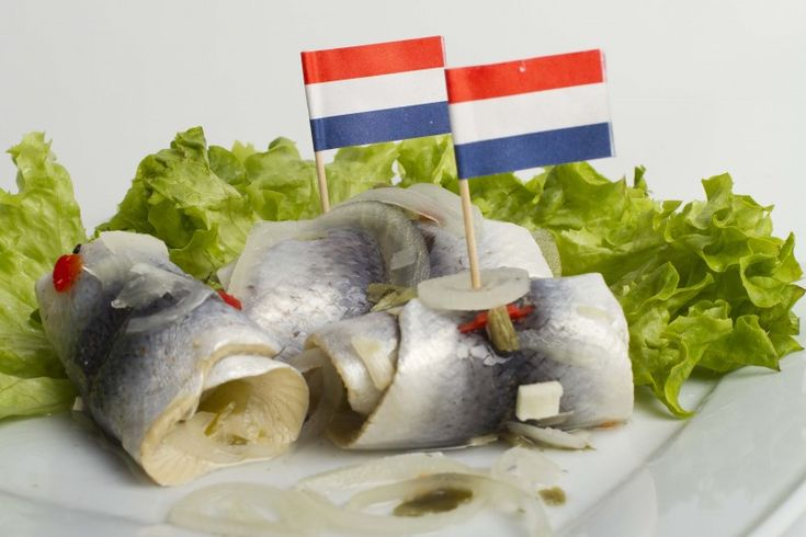 ROLMOPS Rollmops are pickled herring fillets, rolled (hence the name) into a cylindrical shape, often around a savoury filling. The filling is usually slices of onion, pickled gherkin, or green olive with pimento. #dutchfood, #netherlands.