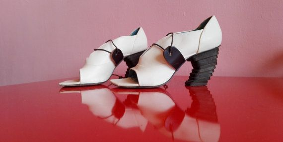 A rare find! White leather high heeled sandals / bridal shoes with striking concept heels. Cute irregular choice shoe design from smooth white leather and with Irregular Choice logo inside. Size is listed as EU 36 but these will fit a 37 (6 to 6.5 US size https://ladieshighheelshoes.blogspot.com/2016/10/womens-shoes.html