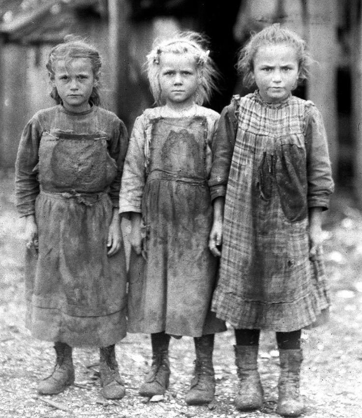 A group of young girls on a break from their jobs as oyster shuckers at a seafood canning company in Port Royal, South Carolina, in 1911. From left to right: Josie (6 years old), Bertha (6 years old), and Sophie (10 years old).