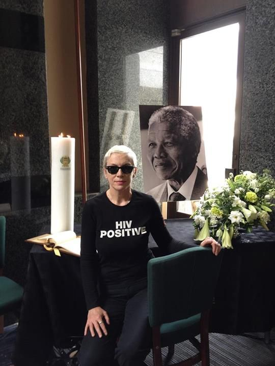 Annie Lennox inside Parliament House in Cape Town on 10 December 2013 at the memorial book signing table for Nelson Mandela. She wears the HIV Positive shirt to raise awareness of her humanitarian project http://en.wikipedia.org/wiki/The_SING_Campaign