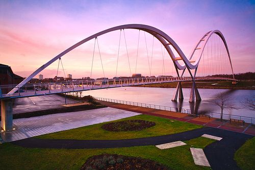 Infinity Bridge, Stockton-on-Tees.  The Infinity Bridge is a public pedestrian and cycle footbridge across the River Tees in the borough of Stockton-on-Tees in the north east of England.