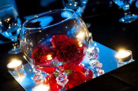 red rose centerpieces with black linens | Mokara Floral Design: Gangster Red, Black and Blue Wedding