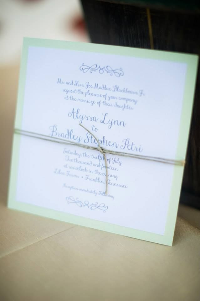 Green and white wedding invitation with twine