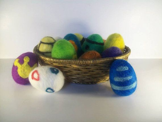 Needle felted pokemon eggs. They are based off the egg of actual pokemons from the anime, so each egg is different for each pokemon. They are not