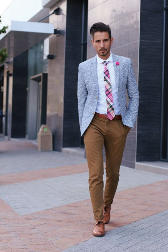 floral blazer, white shirt, pink tartan tie, pink lapel flower, tan leather belt, brown skinny chinos, tan brogues.