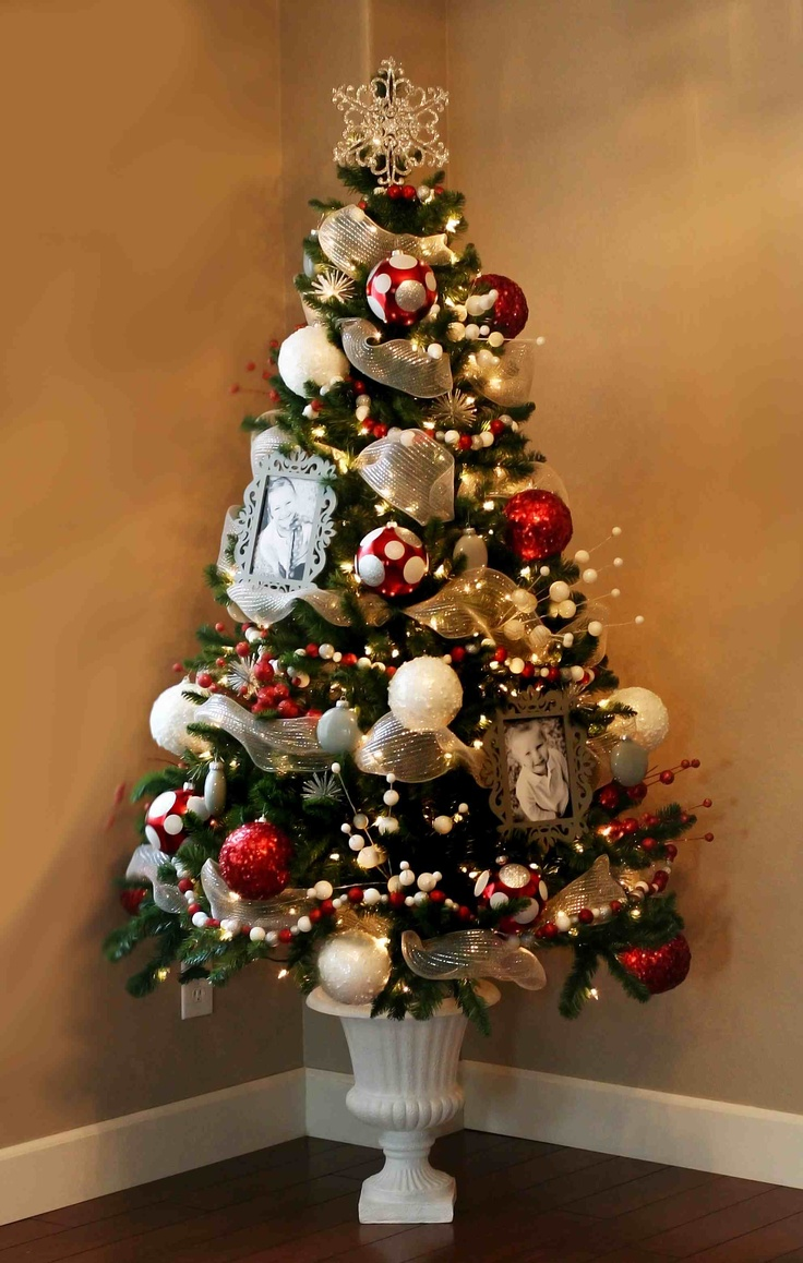 idea for christmas decorating: small fake trees in urns around the house.  Themes for the decorating: Disney, kids tree, etc