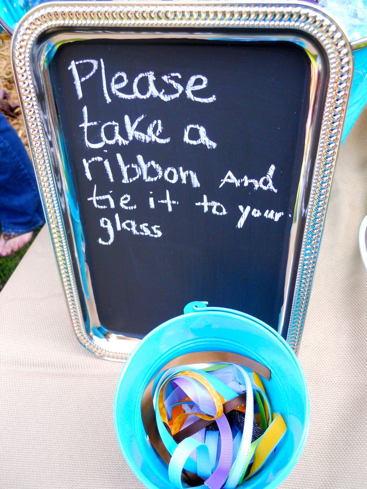 Wine tasting idea...Get a lot of different ribbon scraps and have your guests choose one to tie to their glass.