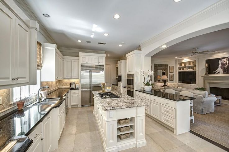 """6429 Westchester West University Place, TX 77005: Photo  Amazing gourmet island kitchen with all 2011 appliances: 48"""" SubZero fridge, Wolf double convection ovens, twin Bosch dishwashers, 5-burner gas cooktop, adjacent to breakfast room and open to den."""