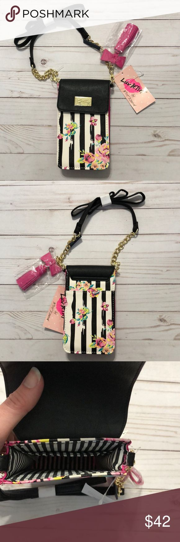 """Betsey Johnson Crossbody Cute Betsey Johnson """"wallet on strings"""" Cream with black stripes, multi colored flowers and hot pink sides! Long black removable strap with gold chain accents and a cute hot pink bow tassel! Back features a pocket while the interior is open with 3 credit card slots on the back! Approximate Measurements: 4"""" wide, 7"""" Tall, 1 1/2"""" deep. So cute! Make an offer!! Betsey Johnson Bags Crossbody Bags"""