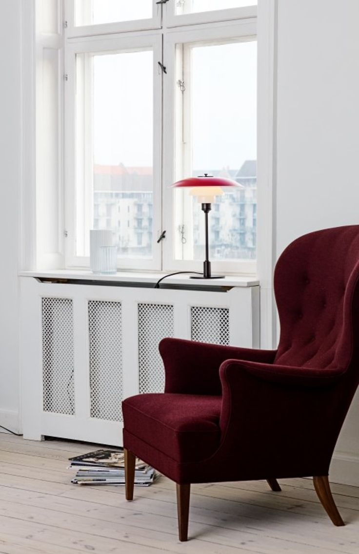 Iconic PH table lamp with a colored lampshade by Poul Henningsen.