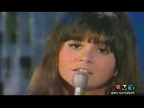 Linda Ronstadt sang Long Long Time in Glen Campbell Goodtime Hour 1970     written by Gary B. White  Universal MCA Music (ASCAP)    Love will abide, take things in stride  Sounds like good advice but there's no one at my side   And time washes clean love's wounds unseen  That's what someone told me but I don't know what it means.     Cause I've ...