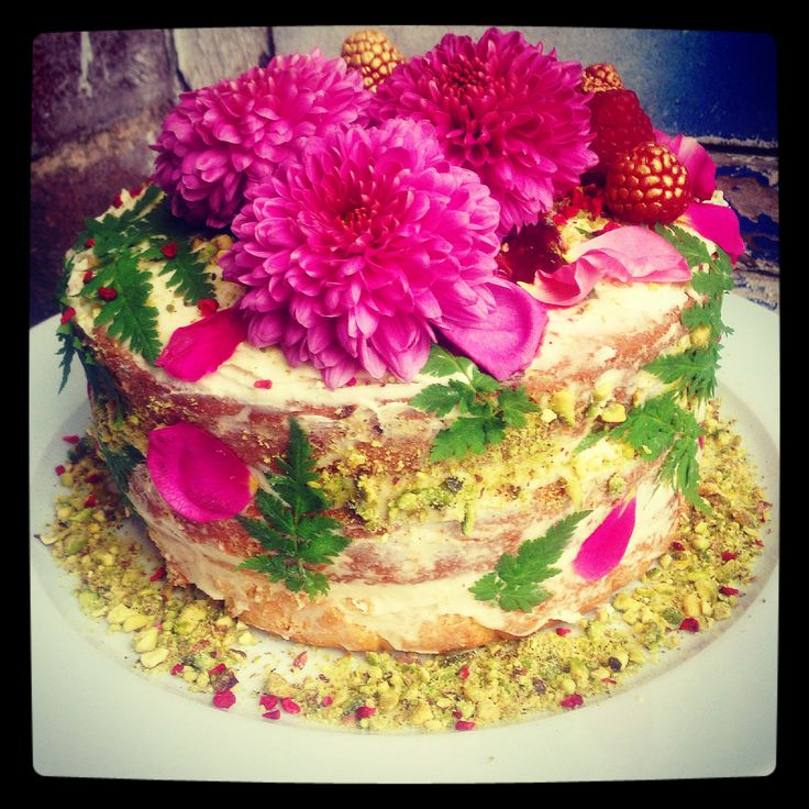 victoria sponge cake with vanilla buttercream, crushed pistachios, freeze dried raspberries, sweet cicely and edible flowers