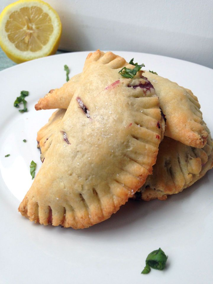 Blueberry Lemon Basil Hand Pies Recipe -- A unique flavor combo that is surprisingly addicting. Not too much sugar either!