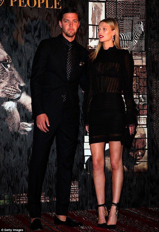 Beautiful people: Model Toni Garrn sported a sheer LBD as she posed alongside handsome boy...