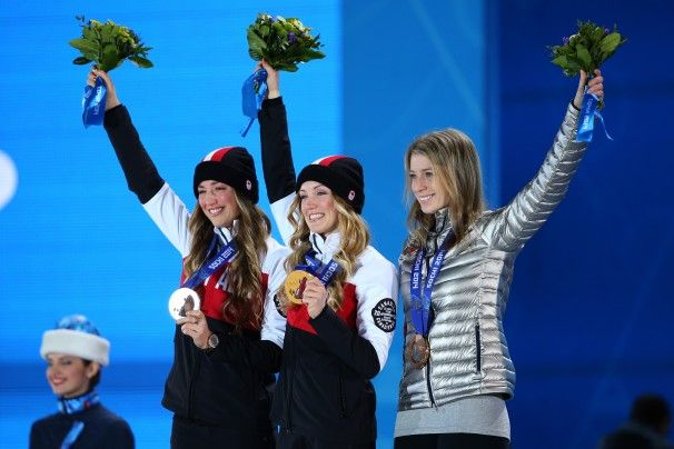 Hannah Kearney, right, won bronze in the women\'s freestyle moguls competition on Feb. 8. Sisters Justine Dufour-Lapointe of Canada, center, won the gold medal, and Chloe Dufour-Lapointe won silver.