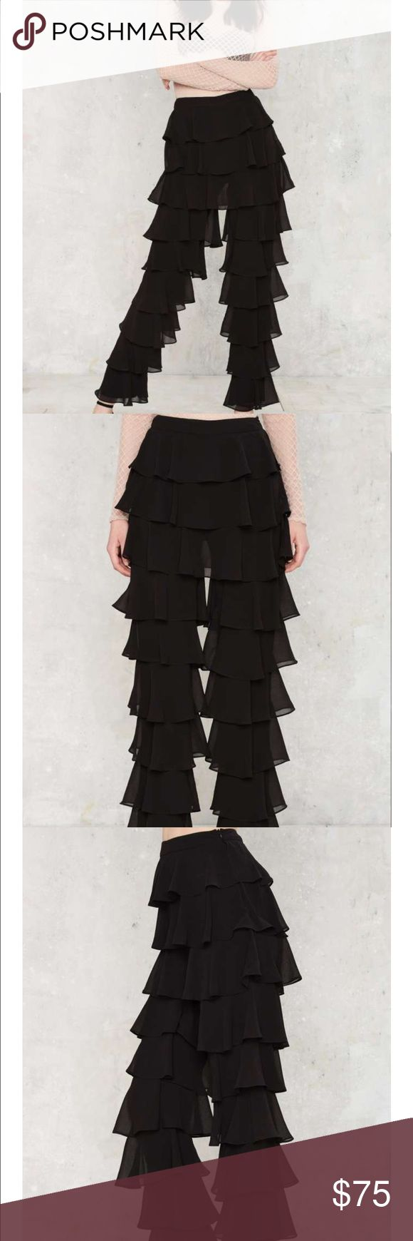 Lavish Alice Ruffle Round the Edges Tiered pants The Ruffle Round the Edges Pants by Lavish Alice come in black and feature pleated ruffle detailing tiered throughout, high-waisted silhouette, full internal skinny trouser lining, and side zip closure.  *Poly *Runs true to size  *Machine wash cold lavish Alice Pants